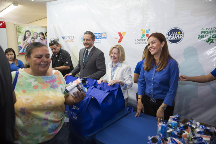 smiling employees at distribution table