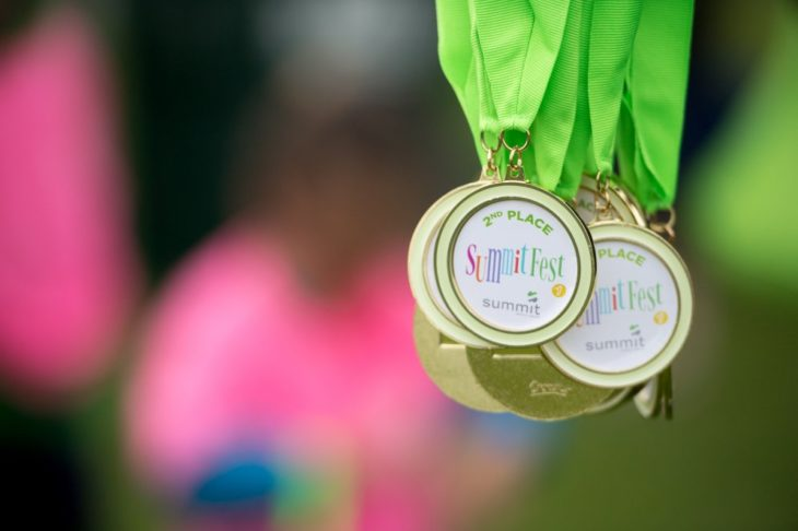 close up of medals on green ribbons