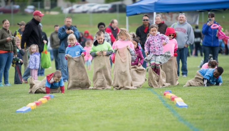 children in a gunny sack race