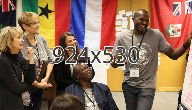 Group of people smiling and learning during a group activity