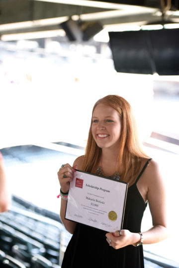 smiling young woman holding certificate