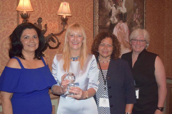 four women accepting award