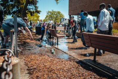 Volunteers clean up at a school after a natural disaster