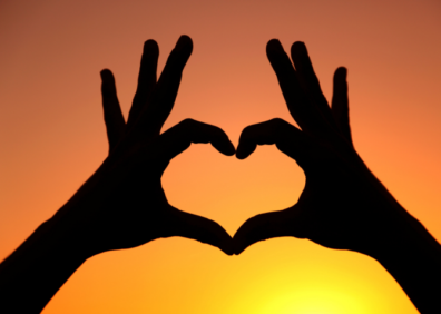 heart with hands in sunset