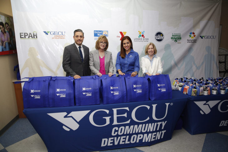four people with good bags to distribute