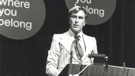 Herb Wegner Speaking on stage