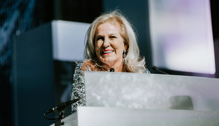 Wegner Award Winner Teresa Freeborn Smiling at Podium