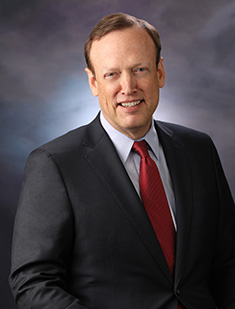 bill cheney smiling