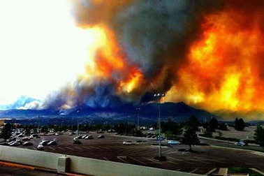 landscape on fire with billowing smoke