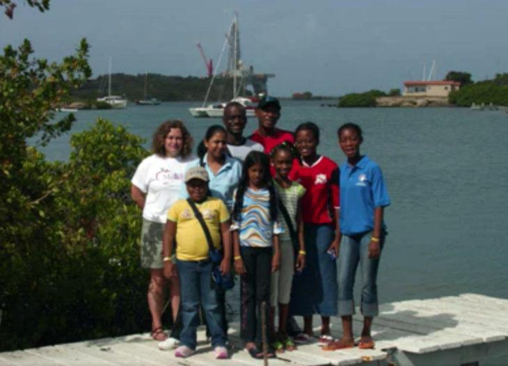 kids and family group posing on pier