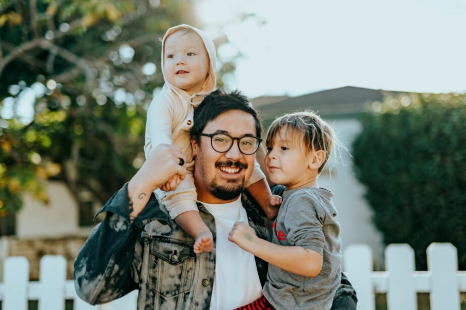 A young Latinx man with his children