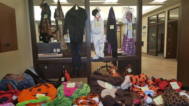 pile of halloween costumes