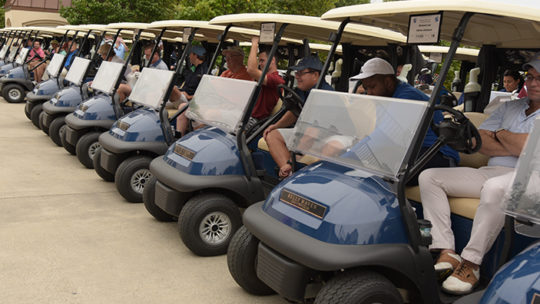 a long line of golf carts ready to head out