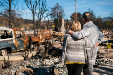 Couple viewing their destroyed home from wildfires